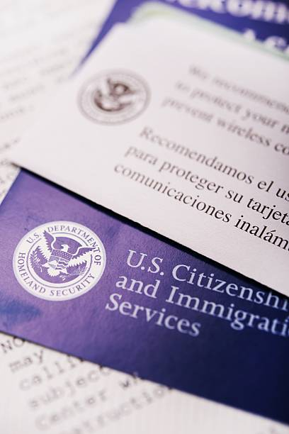 United States Citizenship United States Citizenship and Immigration Flyers and Documents Closeup. green card stock pictures, royalty-free photos & images