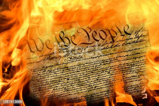 close up of United States constitution document burning in fire
