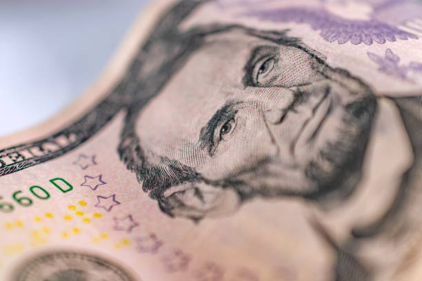 United States Currency five dollar focus on eye stock photo