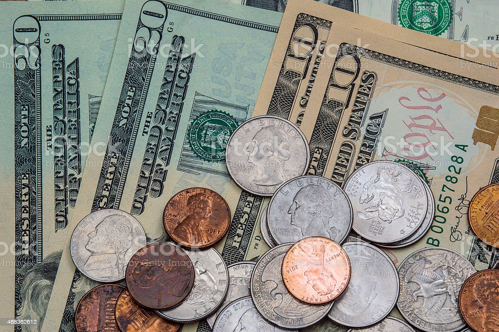 United States Dollars and Coins royalty-free stock photo