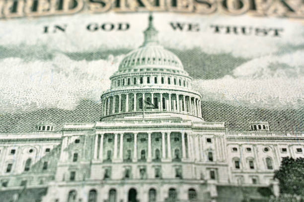 United States fifty dollar bill United States fifty dollar bill with the United States Capitol building close up capitol hill stock pictures, royalty-free photos & images