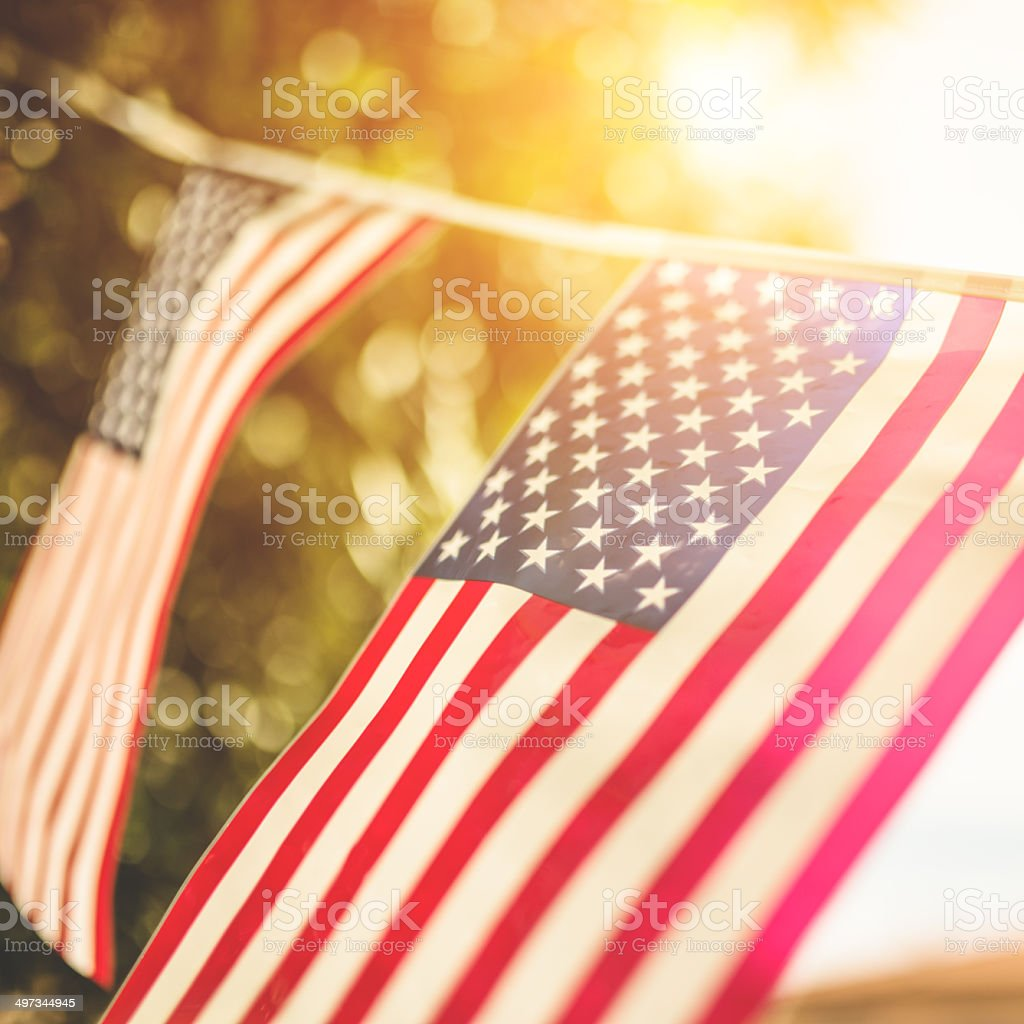 United States flag against the sunlight stock photo