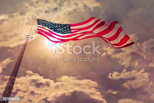 istock United States flag blows in the wind 537898300
