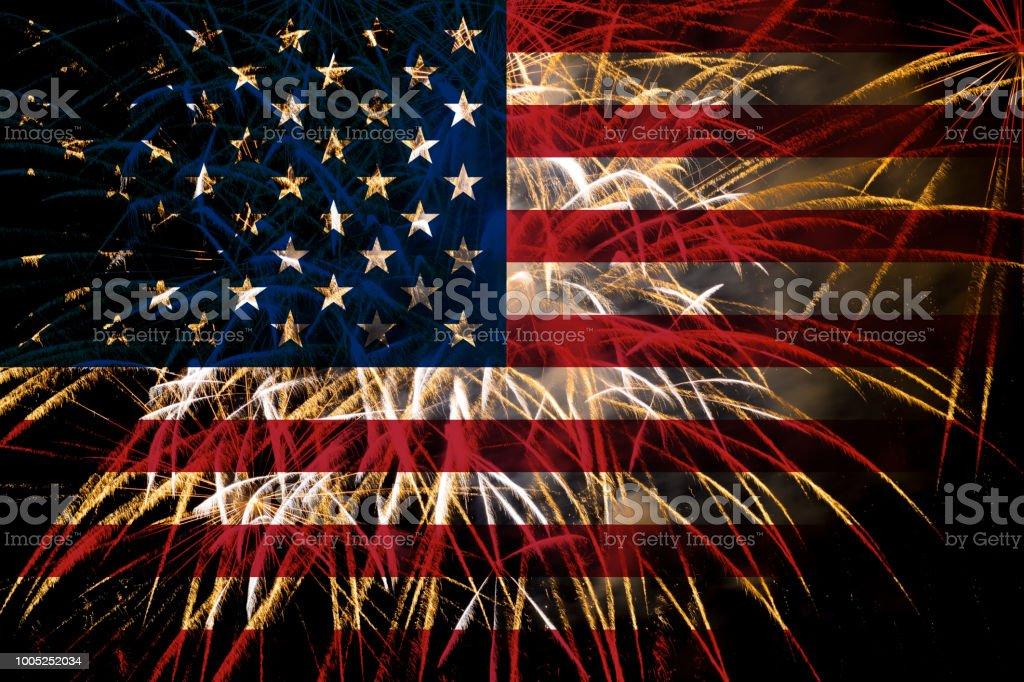 united states flag fireworks on night sky stock photo