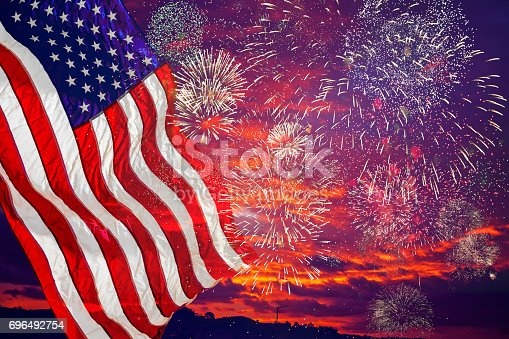 537898300istockphoto United States Flag, lots of fire works against the darkened sky. 696492754