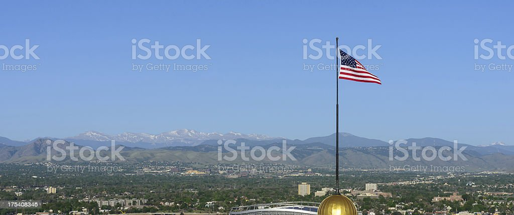 United States Flag on Gold Dome Building stock photo