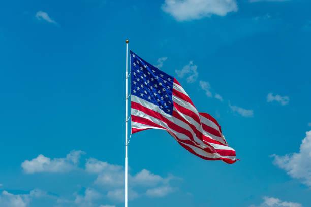 United States flag on pole stock photo