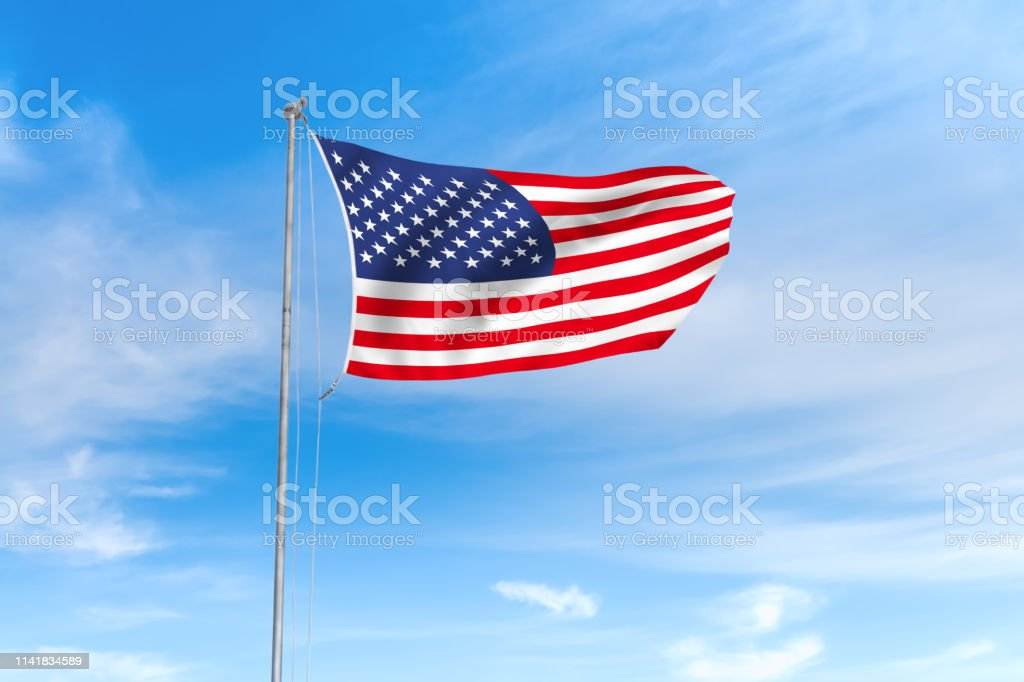 United States USA American flag blowing in the wind over nice blue...