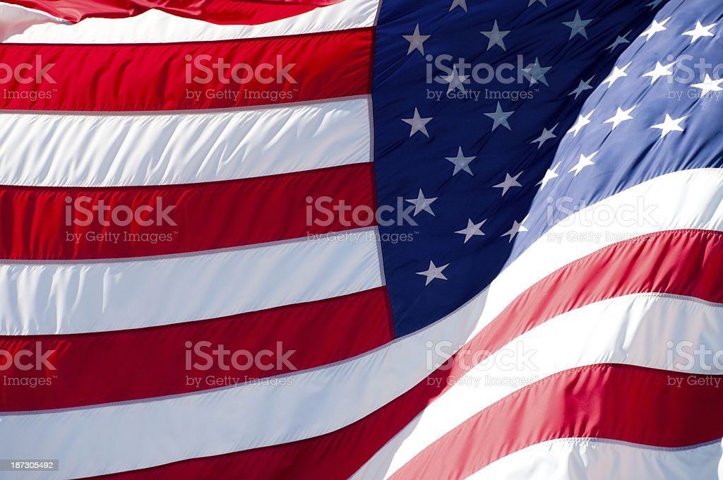 United States flag waving in the wind.