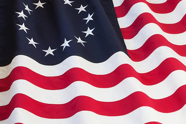 United States flag with thirteen stars stock photo
