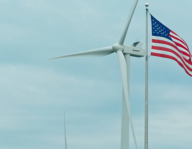 United States flag with wind turbine stock photo