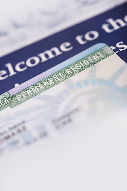 United States Green Card United States Green Card and Welcome Brochures Vertical Closeup Photo. green card stock pictures, royalty-free photos & images