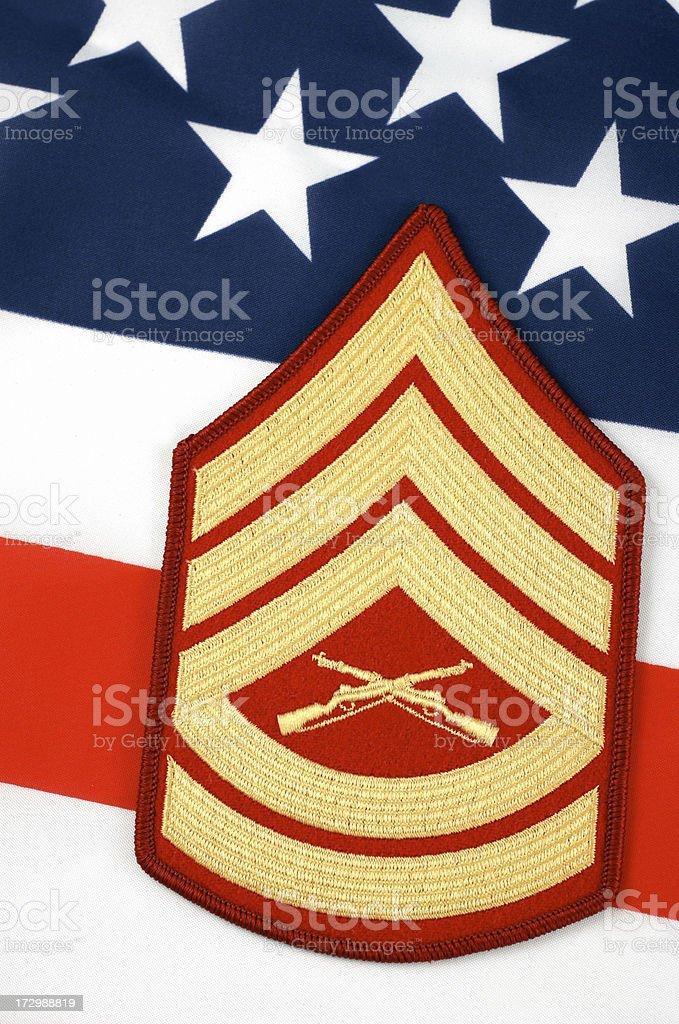 united states marine gunnery sergeant insignia and flag stock photo