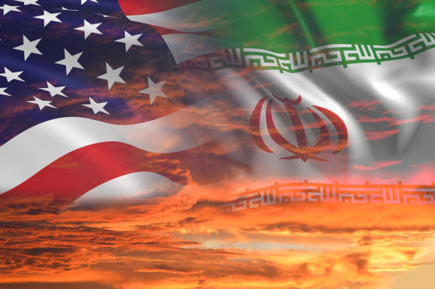 USA United States of America and Iran relations - iran us war with flags on stormy cloudy orange sky background USA United States of America and Iran relations / iran us war with flags on stormy cloudy orange sky background sanctions stock pictures, royalty-free photos & images