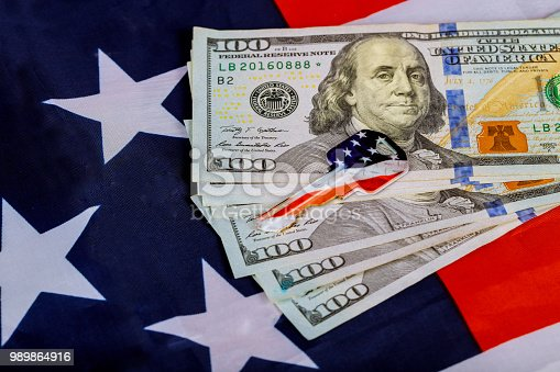 istock United states of america flag Keys on background of money. Concept buying or renting home. 989864916