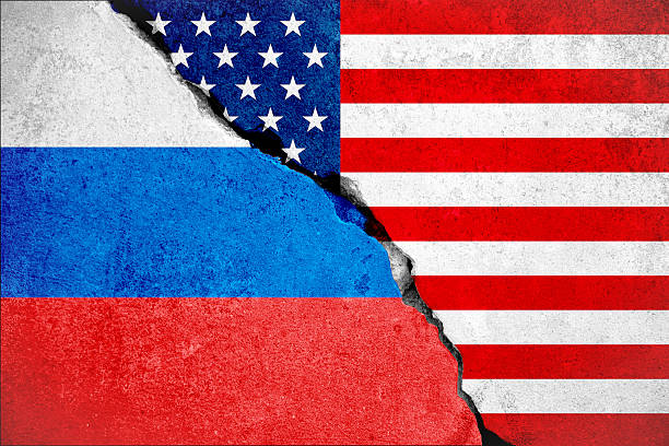 united states of america flag on wall and russian flag - ロシア ストックフォトと画像
