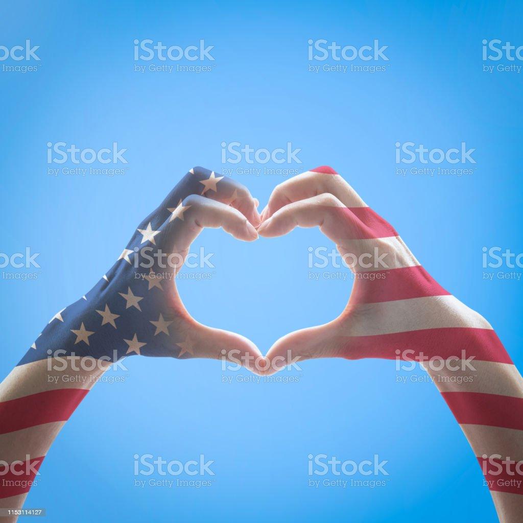 United States of America flag pattern people hands in heart shape