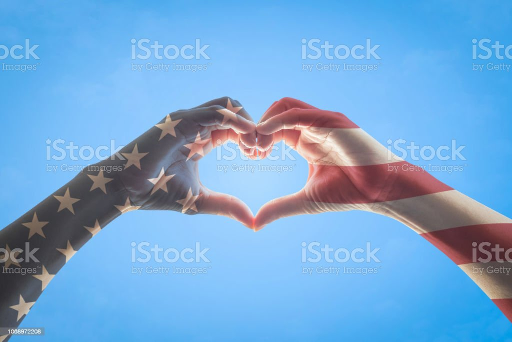 United States of America -USA American flag pattern on people hands...
