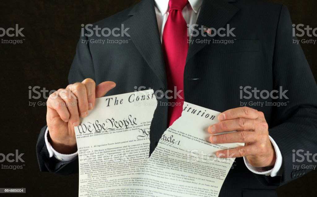 United States politician ripping up and shredding The Constitution stock photo