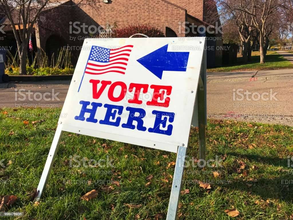 United States Polling and Voting Location Sign A polling location sign for voting in USA. American Flag Stock Photo