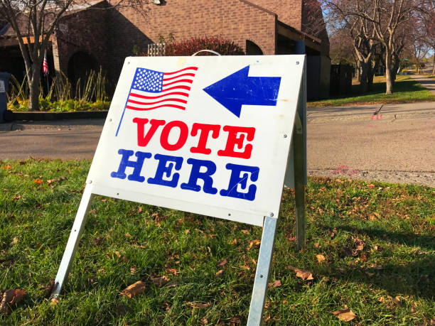 united states polling and voting location sign - vote sign stock photos and pictures