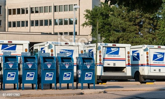 Fort Collins, Colorado, USA - August 16, 2013: Delivery vehicles parked at the United States Post Office in downtown Fort Collins. With almost 600,000 employees, the United States Postal Service is the second largest civilian employer in the United States.