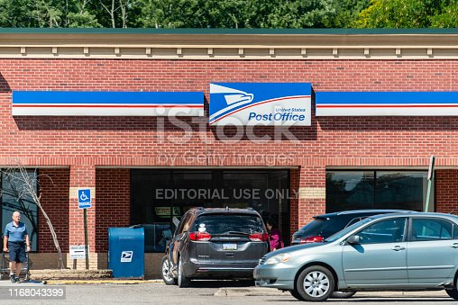 People in front of the United States Post Office on Rochester Road in Rochester Hills, Michigan. The US Postal Service was founded in 1775 with Benjamin Franklin as its first postmaster and today employs almost 600,000 people.