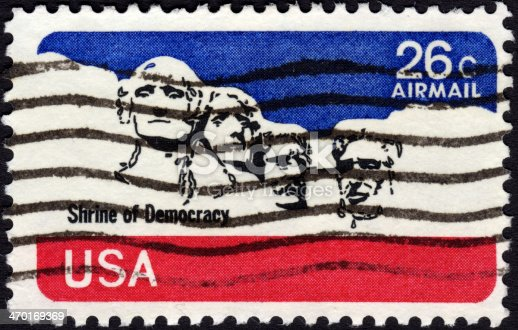 United States postage stamp 1974 in the value of 26c showing former presidents' heads at Mount Rushmore and the print 'Shrine of Democracy'