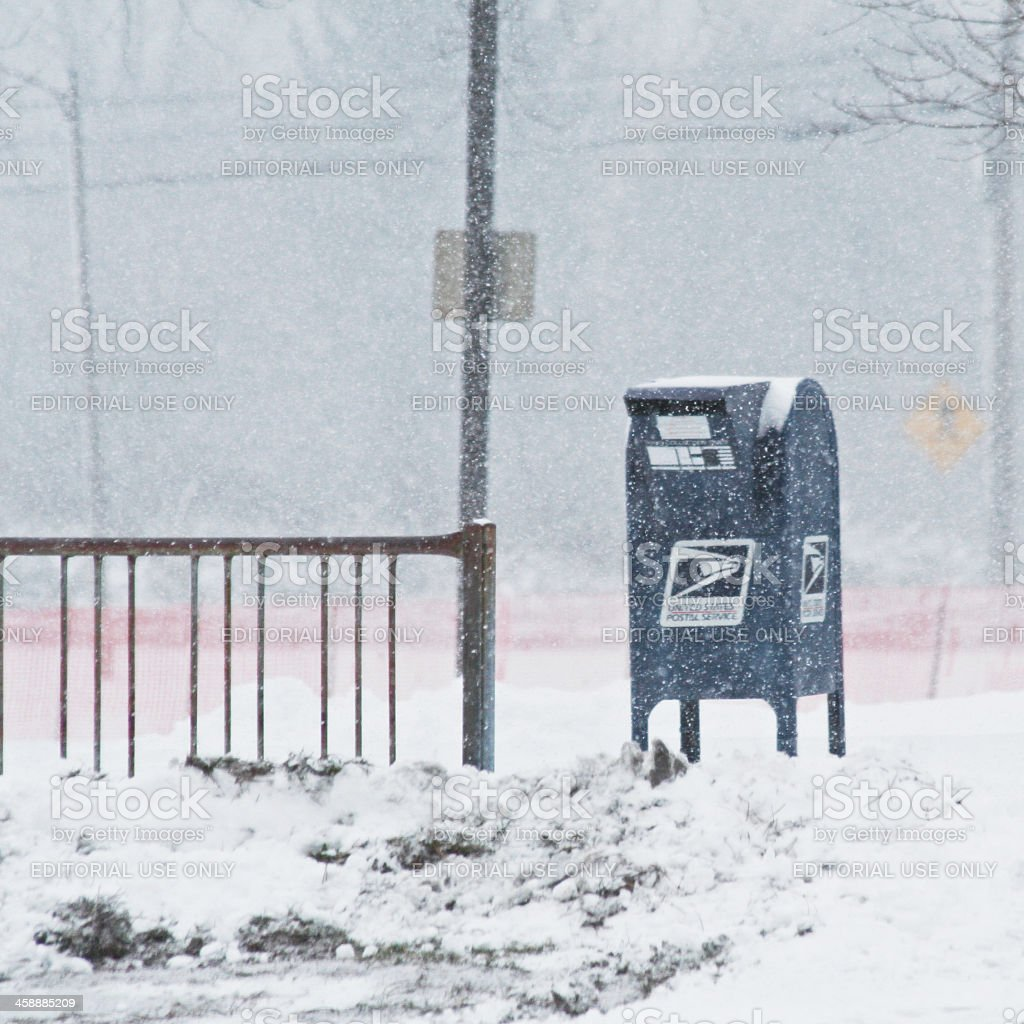 United States Postal Service Collection Box in a Blizzard stock photo