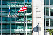 Washington DC, USA - October 12, 2018: US United States Securities and Exchange Commission SEC architecture modern building sign logo red flag and glass windows