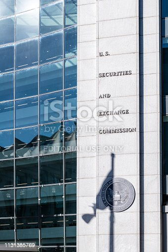Washington DC, USA - October 12, 2018: US United States Securities and Exchange Commission SEC architecture closeup with modern building sign and logo with flag shadow by glass windows