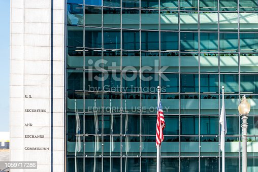 Washington DC, USA - October 12, 2018: US United States Securities and Exchange Commission SEC entrance architecture modern building sign, logo, american flag, glass windows