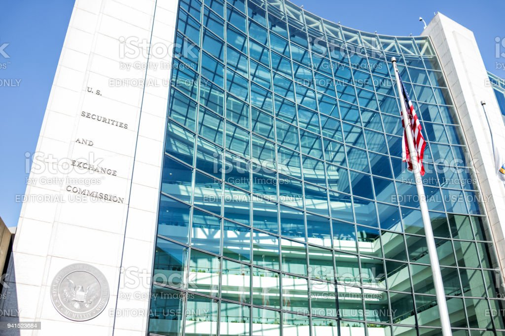 US United States Securities and Exchange Commission SEC entrance architecture modern building sign, logo, american flag, looking up sky, glass windows reflection stock photo