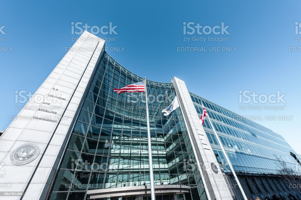 US United States Securities and Exchange Commission SEC entrance architecture modern building sign, entrance, american flag, looking up sky, glass windows reflection stock photo