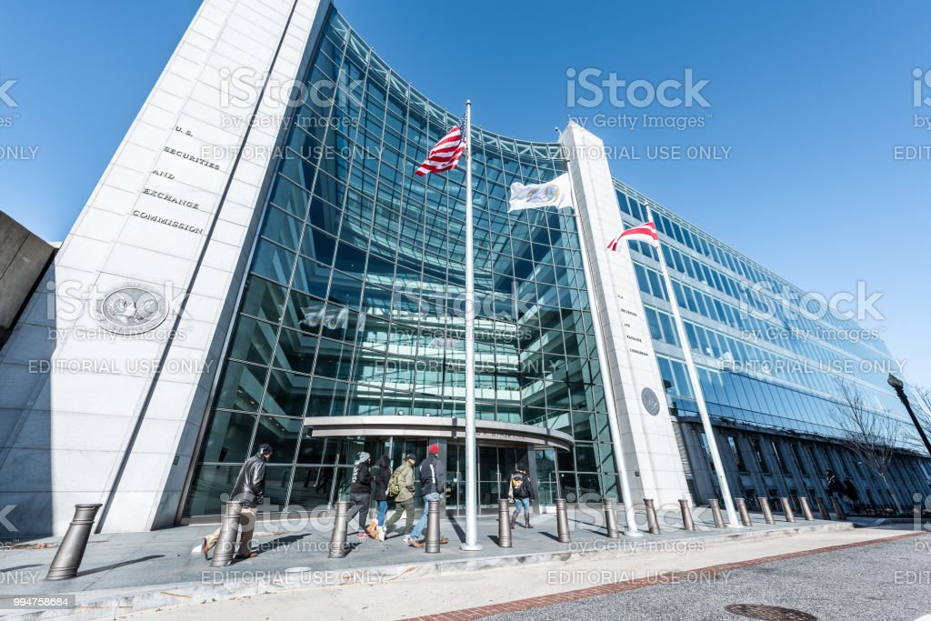US United States Securities and Exchange Commission SEC entrance, people walking, sign, entrance, american flag, looking up sky, glass windows reflection stock photo