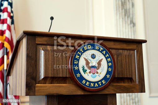 Washington D.C, USA – January 18, 2017: The United States Senate podium in the Washington D.C. capitol building also known as Capitol Hill.  The podium is where U.S. senators speak about upcoming bills and hearings, but the podium is empty because congress is not in session due to the inauguration of Donald J Trump for US president.