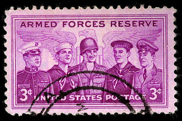 """United States Stamp Commemorating  Armed Services Reserve, Eagle Background """"A United States Stamp Commemorating  Armed Services Reserve with stylized Eagle and Shield Background. Members of the Army, Navy, Air Force, Marines and Coast Guard Reserves are Depicted"""" war effort stock pictures, royalty-free photos & images"""