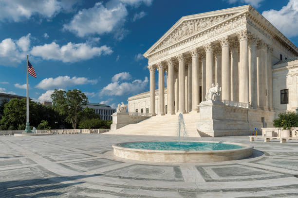 United States Supreme Court Building at sunny day United States Supreme Court Building  at sunset in Washington DC, USA. federal building stock pictures, royalty-free photos & images