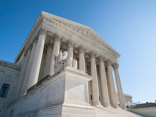 United States Supreme Court Building Facade United States Supreme Court Building Facade in Washington DC. us supreme court building stock pictures, royalty-free photos & images