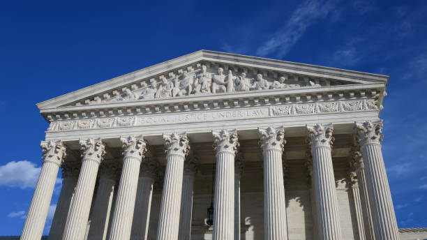 United States Supreme Court Building with Blue Sky Background stock photo