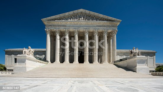 United States Supreme Court full frontal view, brilliant blue sky, No People