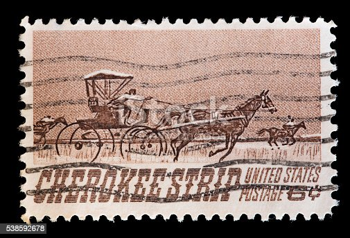 UNITED STATES OF AMERICA - CIRCA 1968: A used postage stamp printed in United States shows a stagecoach drawn by horses along the Cherokee Strip of Kansas, circa 1968