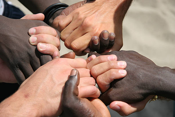 Unity 2 Black and white hands joined together apologist stock pictures, royalty-free photos & images