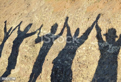 istock Unity and success and friendship concepts, shadow of group of women holding hands after finishing hiking in the mountain 843012746
