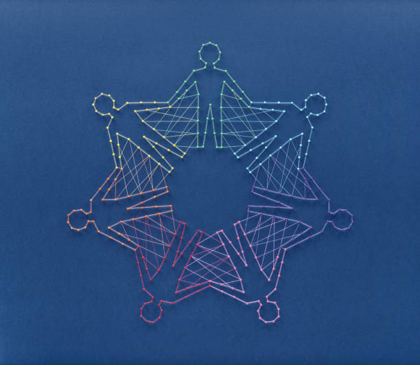 Unity in diversity concept Unity without uniformity and diversity without fragmentation. Network of pins and threads in the shape of people holding hands symbolising community around the world. customs stock pictures, royalty-free photos & images