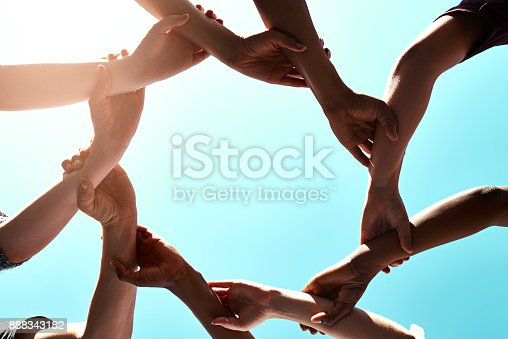 Cropped shot of a group of unidentifiable businesspeople joining their hands in a gesture of unity