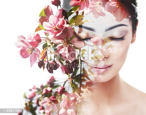 Unity of human with nature, beauty of youth and femininity. Double exposure portrait of young pretty woman combined with bright spring garden flowers