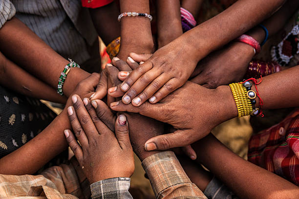 Unity of Indian children, Asia Children's hands in one of Indian villages showing unity.  human rights stock pictures, royalty-free photos & images