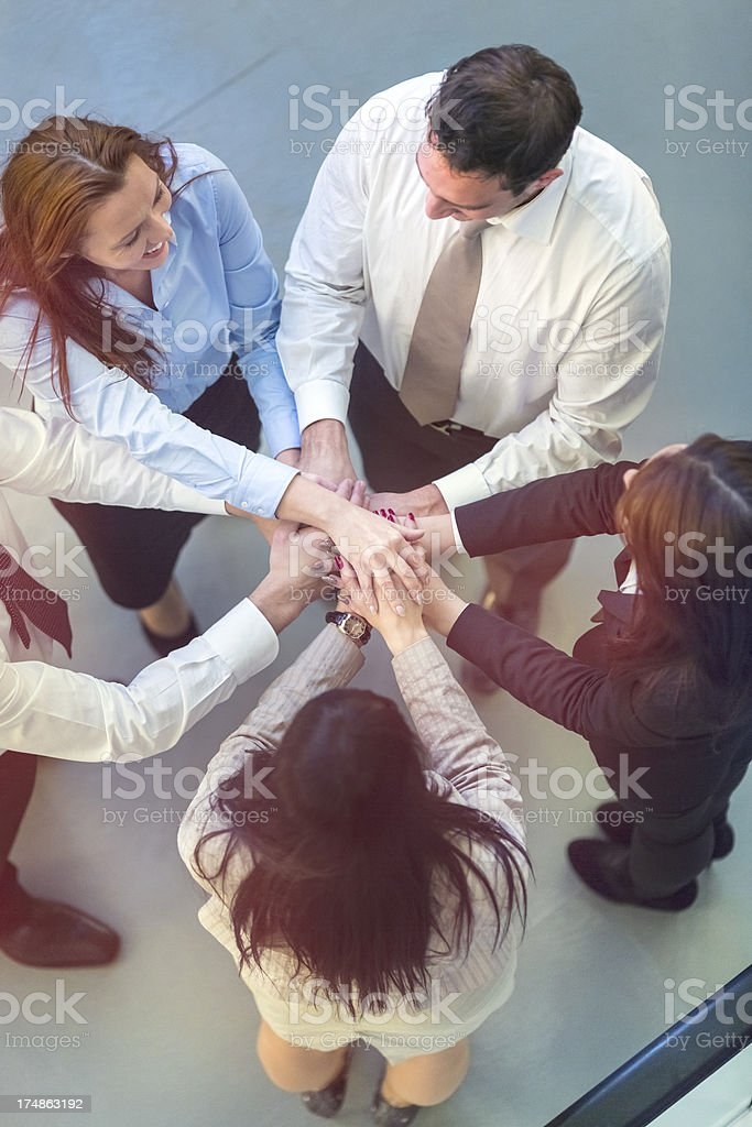 Unity of successful business people holding hands royalty-free stock photo