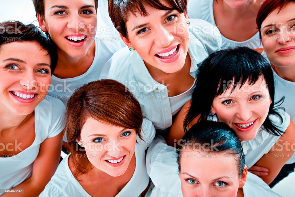 Unity Group of women smiling at the camera. Elevated view. Adult Stock Photo